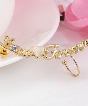 Piercing náušnica s nápisom LOVE FOREVER v zlate farbe