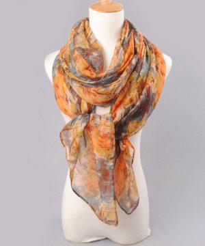 Elegantný šál s abstraktným motívom v pomarančových farbách