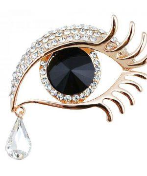 Zlatá brošňa na šaty v tvare oka so slzou