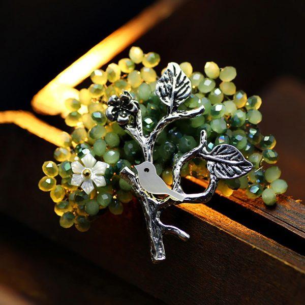 Luxusná brošňa v tvare kryštáloveho stromu s vtáčikom
