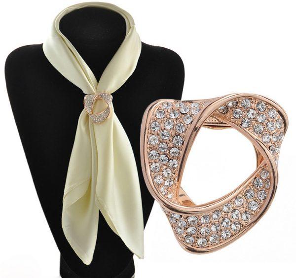 Luxusná zlatá brošňa s kryštálikmi