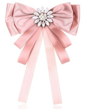 Elegantná brošňa v tvare mašle s ozdobou v ružovej farbe